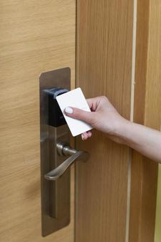 Hotel service Hand holding the card key