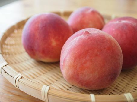 Peach on a bamboo colander