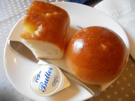Glossy bread rolls and milk bread