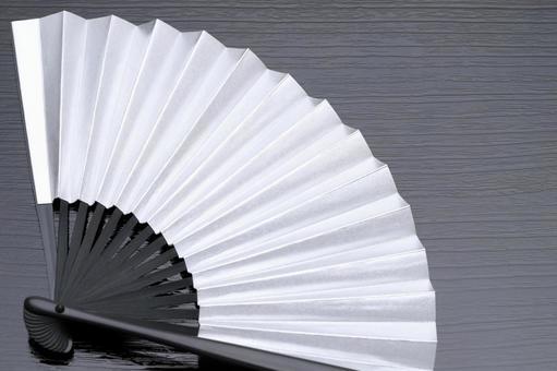 Silvery folding fan
