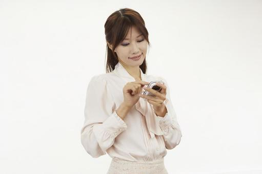 A woman holding a mobile phone 19