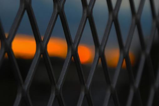 Fence and dusk