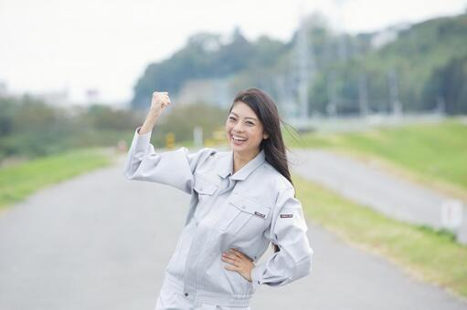 A young woman in work clothes of guts pose (outdoor) 1
