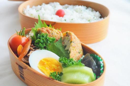 Japanese lunch box served in a bento bento box_boiled egg and tofu hamburger