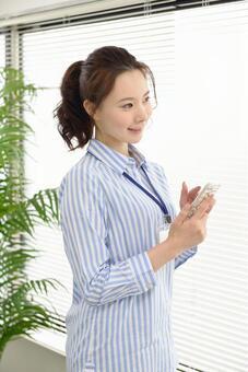 Career woman using a smartphone 4