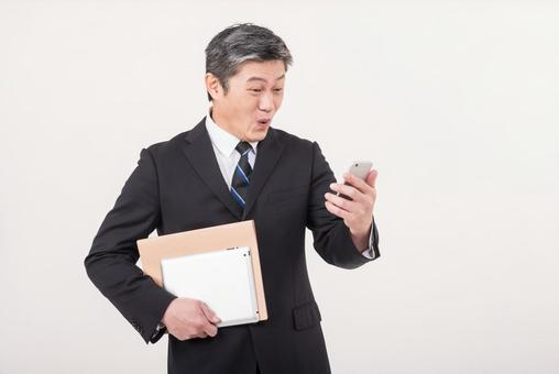 Men in their 50s who are surprised to see mails from business partners