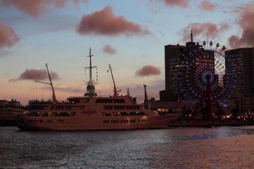 Ferris wheel and boat at dusk