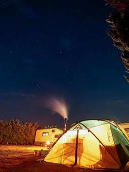 Image of camping under the starry sky in winter