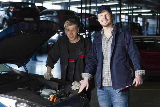 Automobile mechanic checking bonnet 16