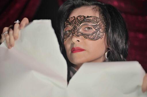 Female fortune teller tearing paper