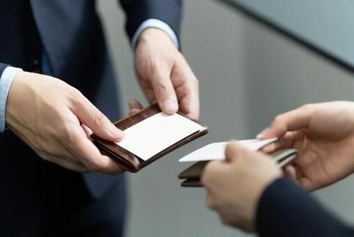 Improving the hands of businessmen exchanging business cards