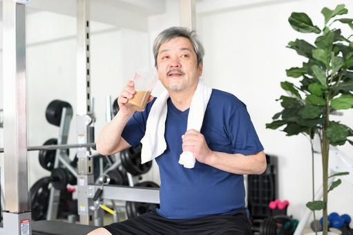 White-haired senior man drinking protein