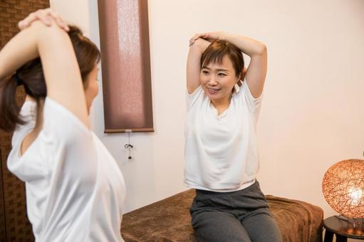 Woman learning to stretch