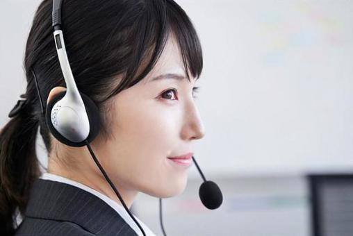 Japanese female business woman answering inquiries at the office