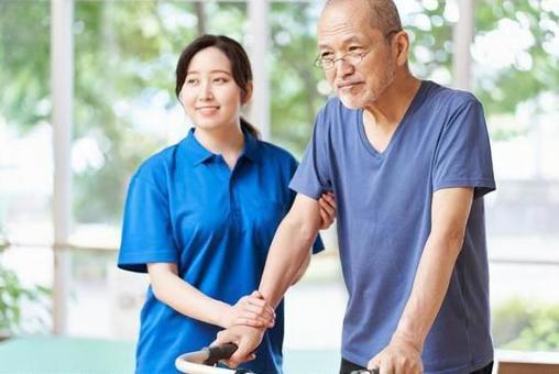 Elderly people walking with walking assistance