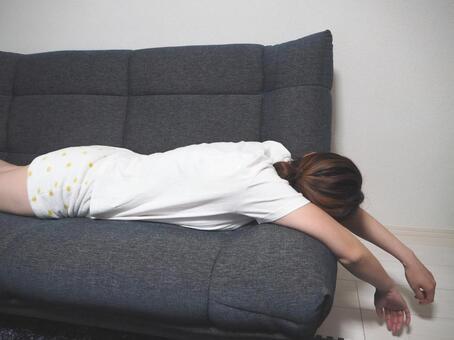Woman drooling on sofa