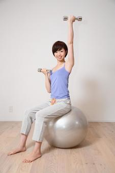 A woman holding a balance ball 19