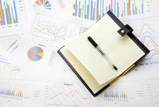 Business chart and notebook