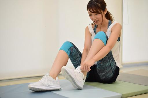 Woman getting ready in dance studio