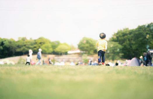 Back view of playing child