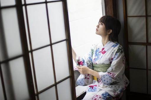 Yukata woman sitting by the window