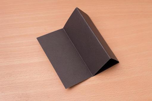 Stand on a desktop black paper