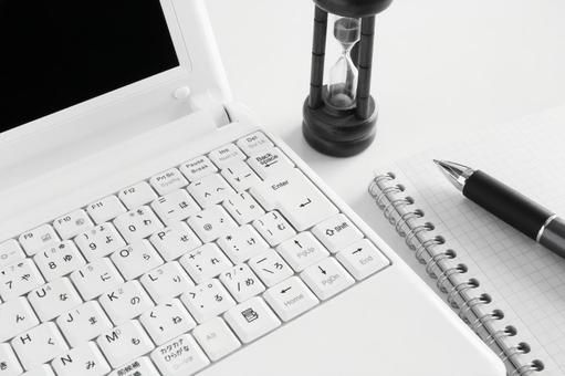 Personal computer and hourglass monochrome
