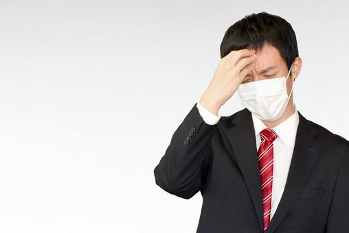 A businessman in a mask