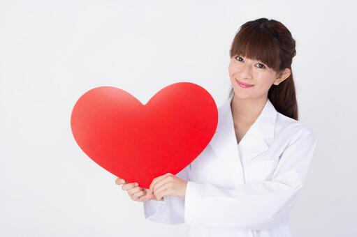 Female doctor with a heart