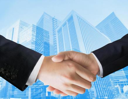 Businessman shaking hands - Blue skyline background