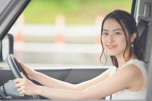 Young woman driving 2