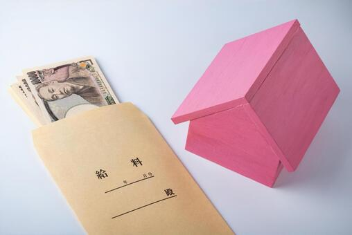 Image of mortgage repayment and rent payment (salary bag and model of house)