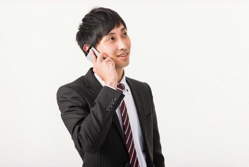 Businessmen placing mobile phones in their ears 4