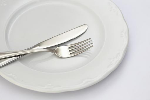 White dish and knife and fork