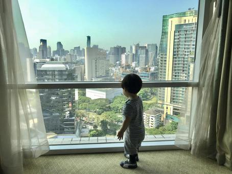 Child looking out on high floor