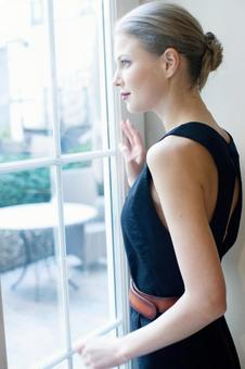 A woman looking outside 1