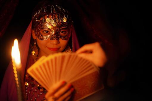 Female fortune teller with a card