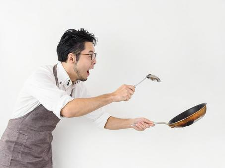 Image of a man who can not cook and is in a hurry