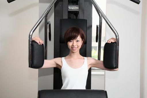 A woman using a training machine 4