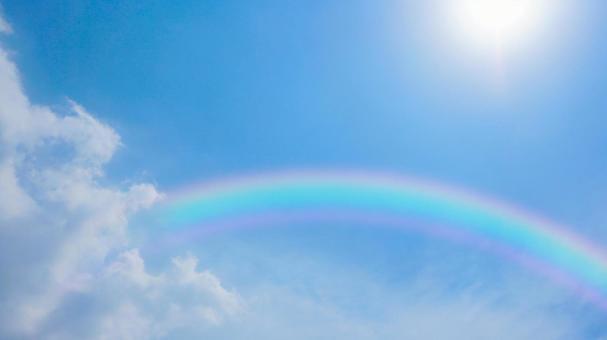 Sky, sun and rainbow