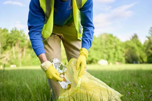 Volunteer man picking garbage