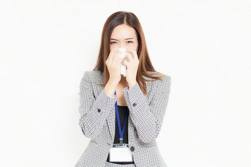 Business woman blowing her nose with tissue