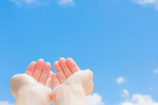 Blue sky and hand