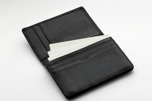 Black business card holder on white background