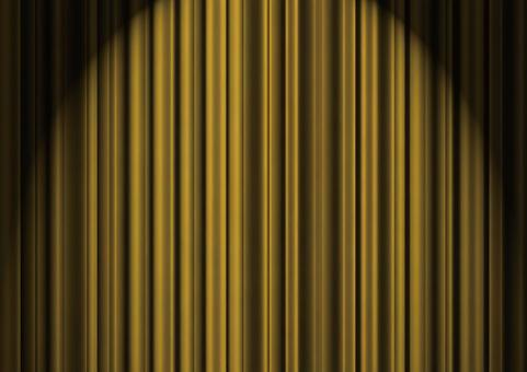 Golden stage curtains in the spotlight