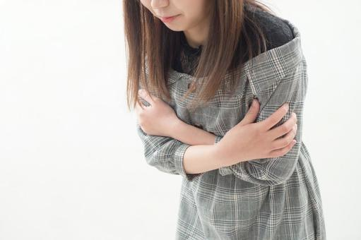 Image of a woman who feels cold
