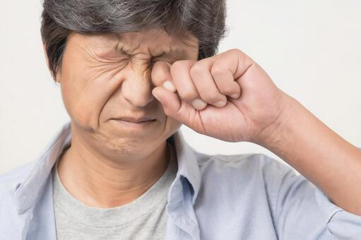 Middle-aged man rubbing his eyes