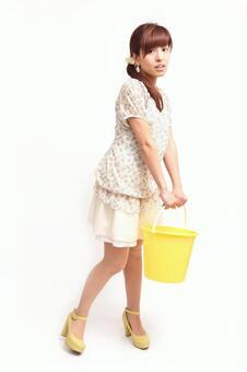Lady to lift bucket 1