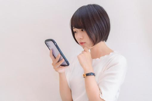 A woman who is worried about seeing a smartphone
