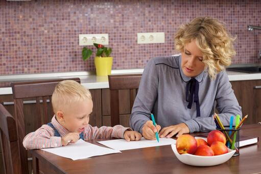 Working mother who holds a son's drawing opponent at the table 8